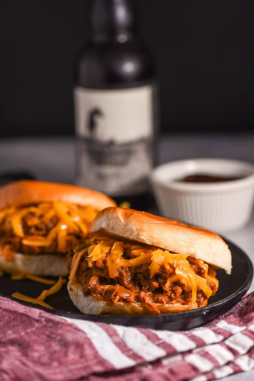 Slow Cooker Barbecue Chicken Sandwiches on a plate with a beer