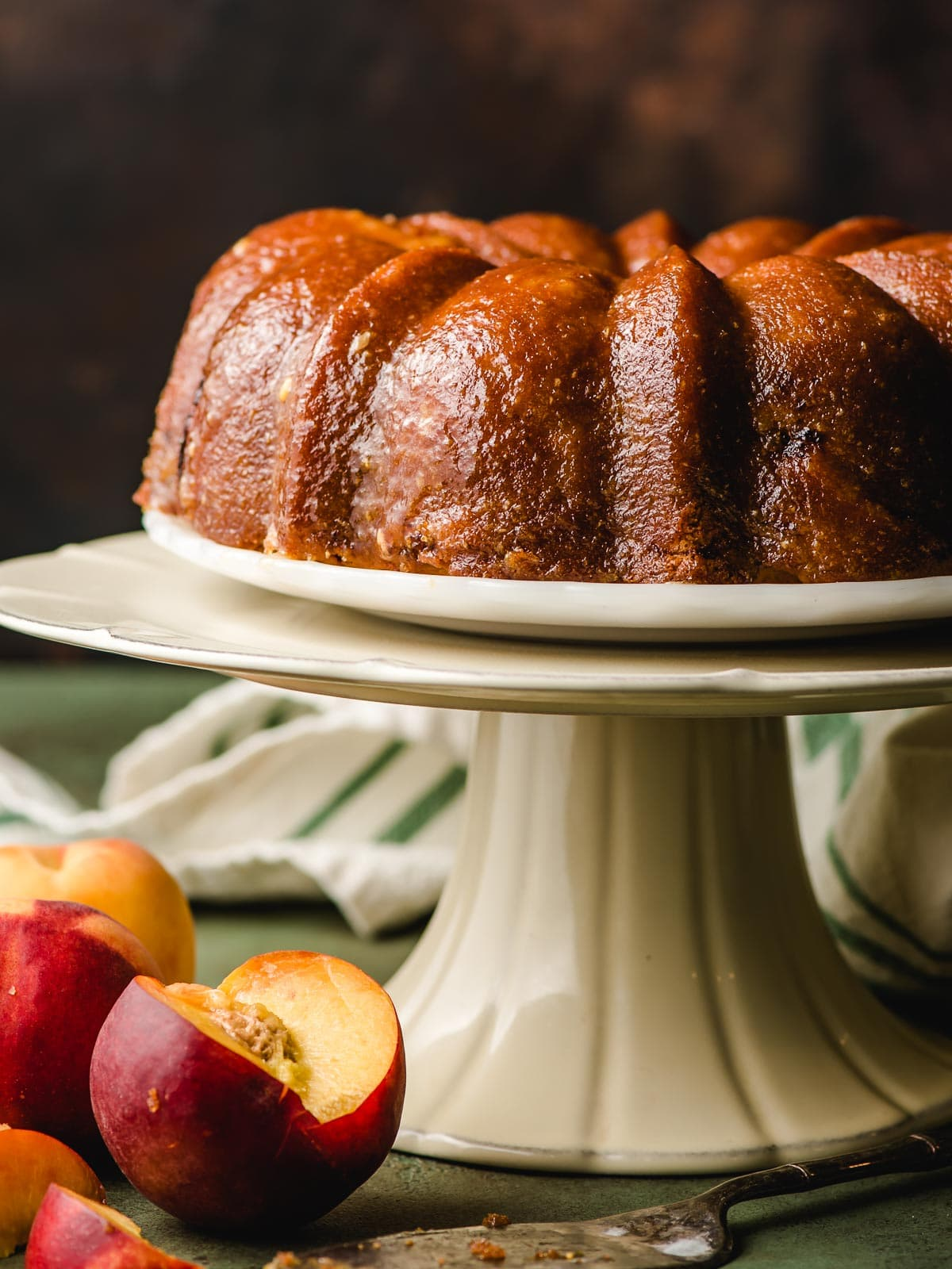 Bourbon Peach Bundt Cake on cake stand.