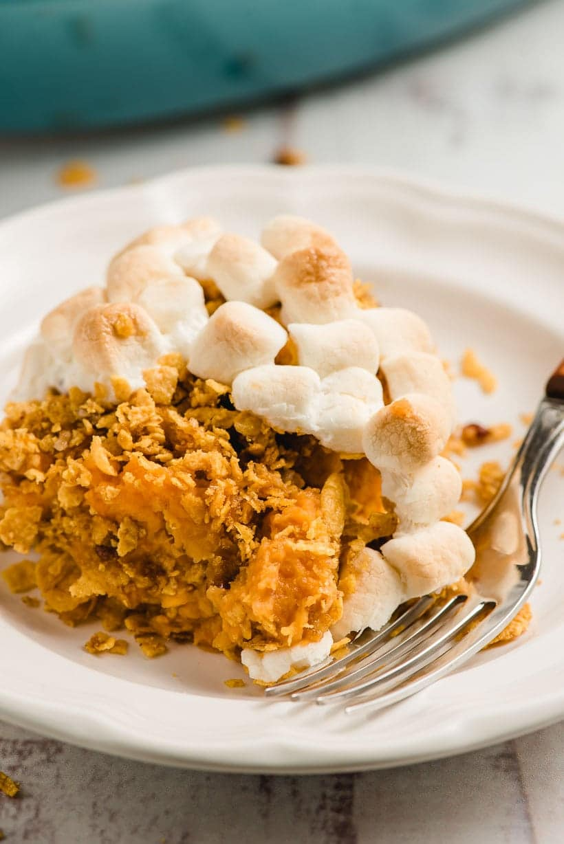 scoop of sweet potato casserole with cornflakes and marshmallows