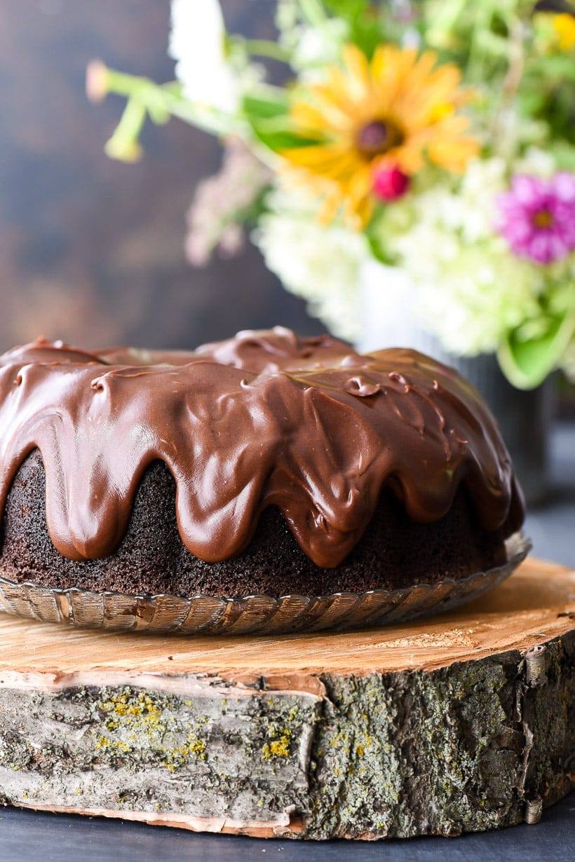 Best Chocolate Bundt Cake with glaze on a glass plate