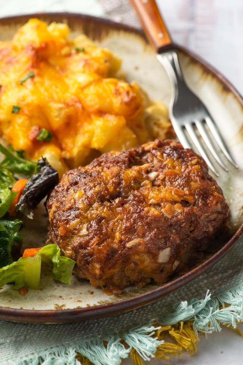 mini meatloaf recipe on a plate with fork and potatoes