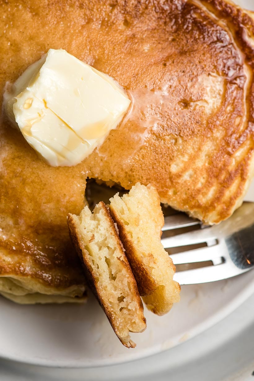 buttermilk pancakes stacked on a fork