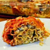 Italian Sausage Pesto Lasagna Rolls
