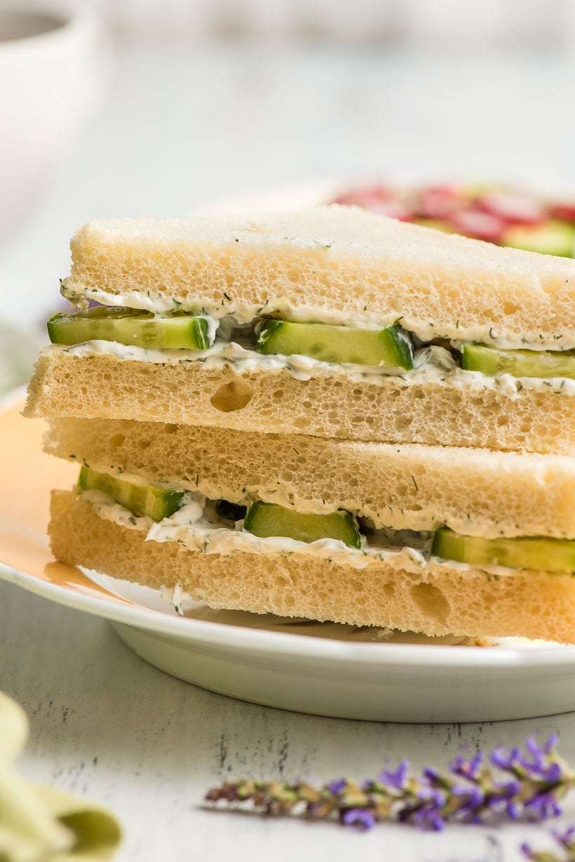 Cucumber Sandwiches stacked on a plate