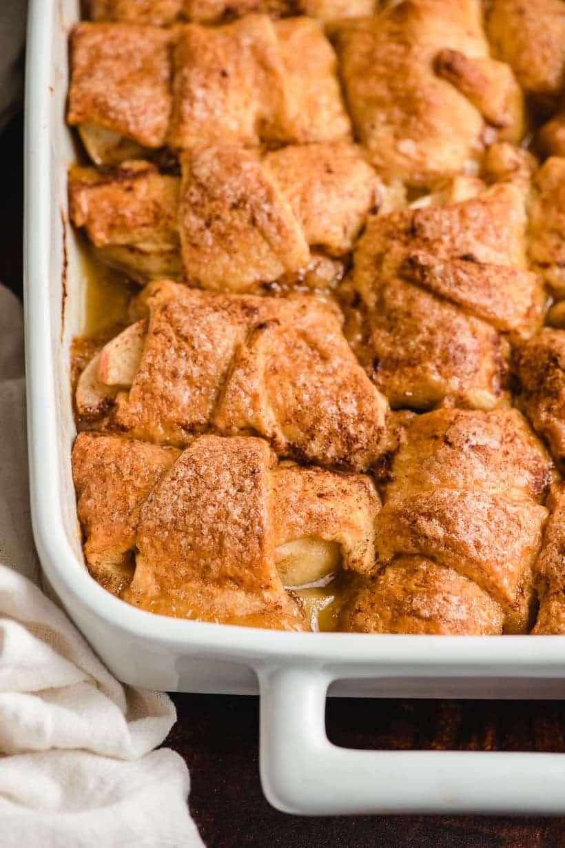 white dish full of crescent roll apple dumplings