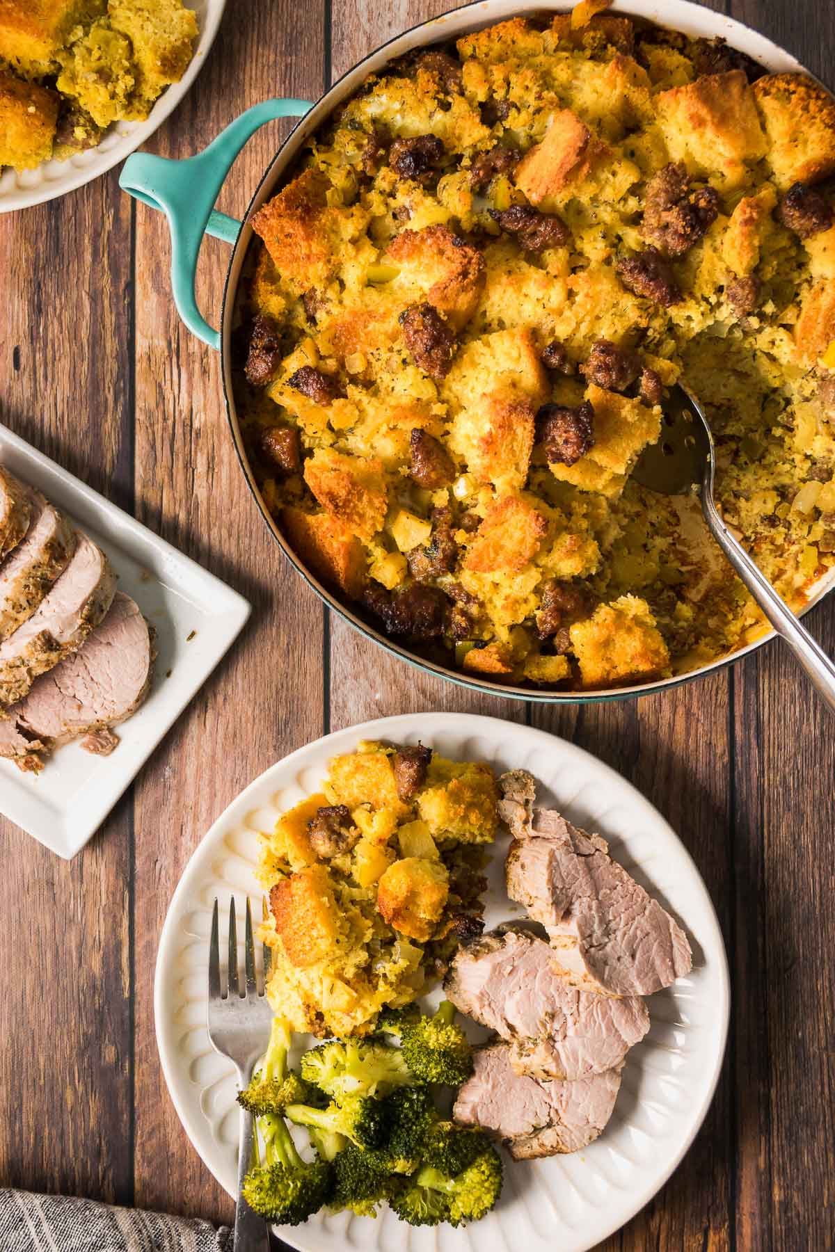 Plate with a serving of gluten free cornbread dressing, sliced pork, and broccoli.