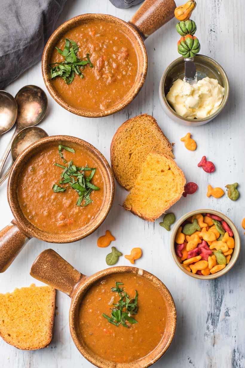 3 bowls of vegan lentil soup with bread
