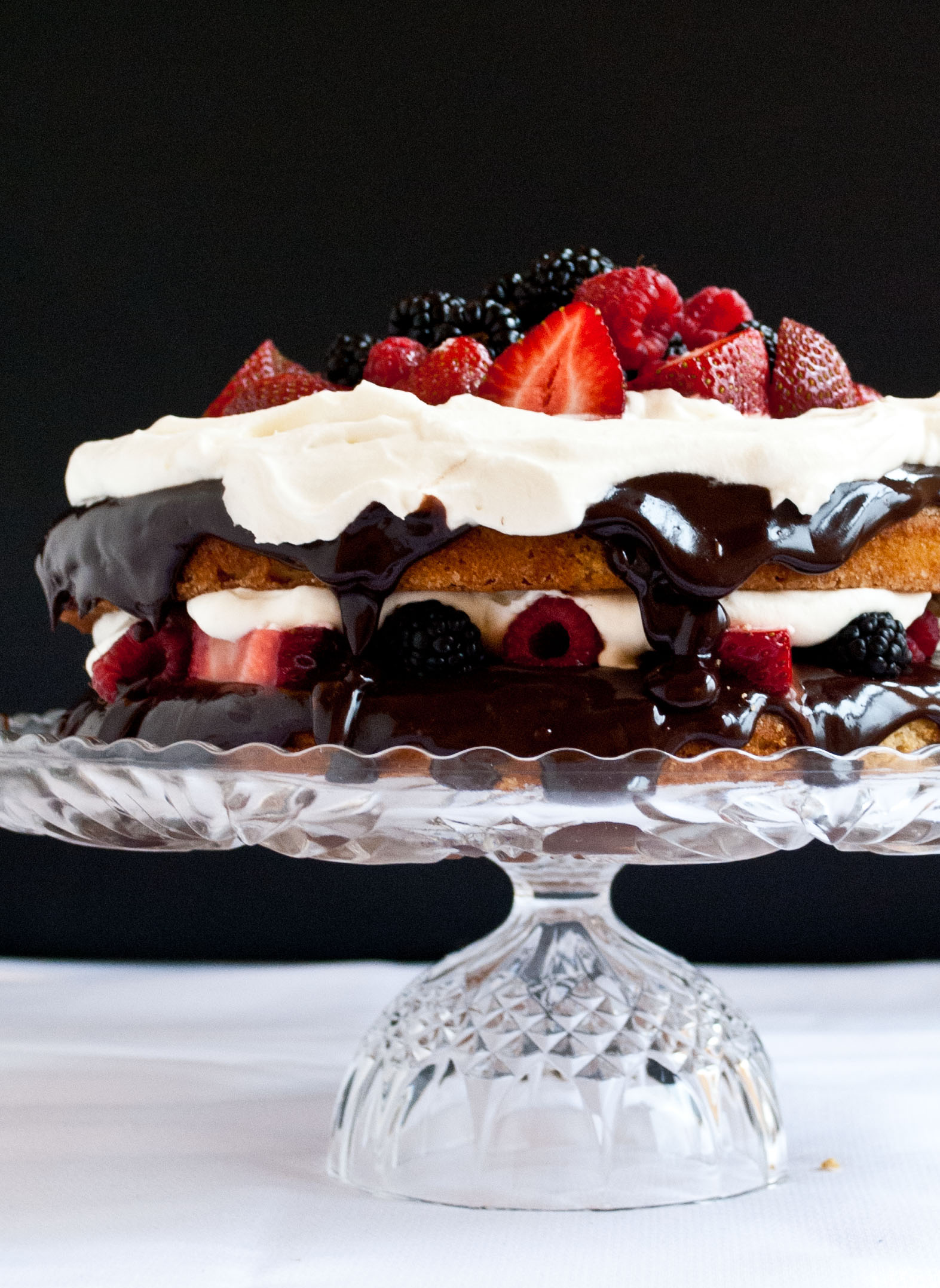 Gluten Free Coconut Cake with Fresh Berries, Ganache, and Whipped Cream | Neighborfoodblog.com