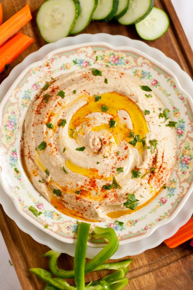 Picture of Homemade Hummus surrounded by cut vegetables from overhead