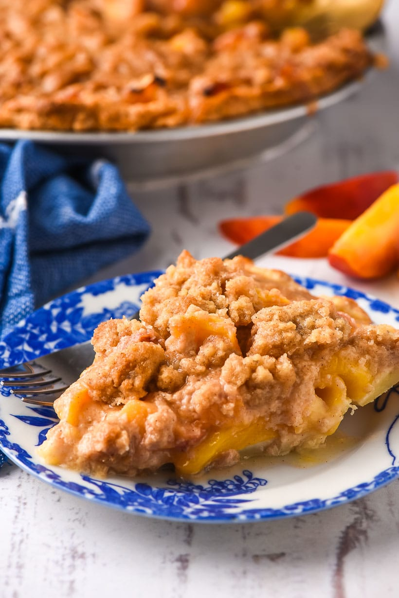 slice of peach crumble pie