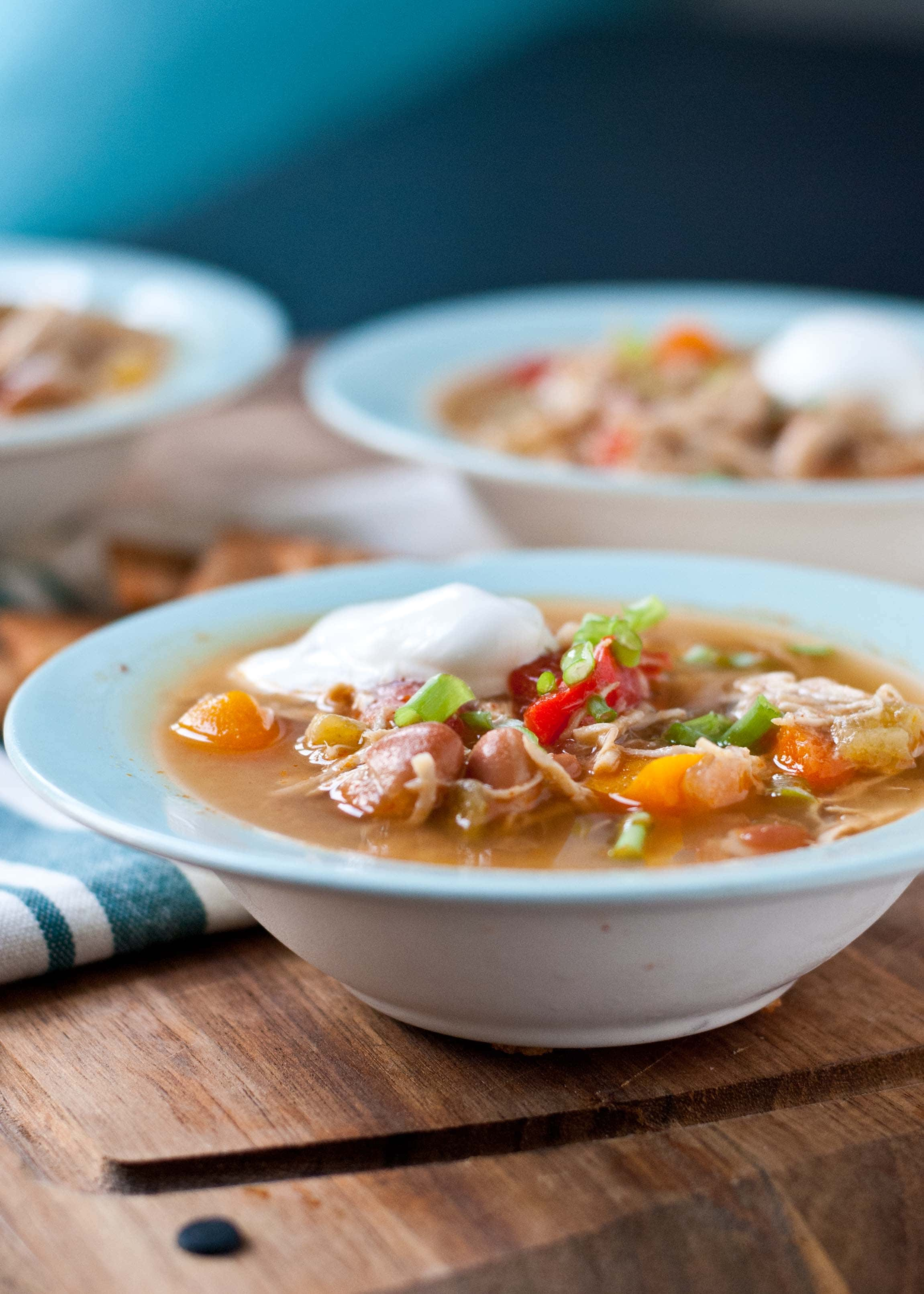 Cozy up with a bowl of this Slow Cooker White Chicken Chili!