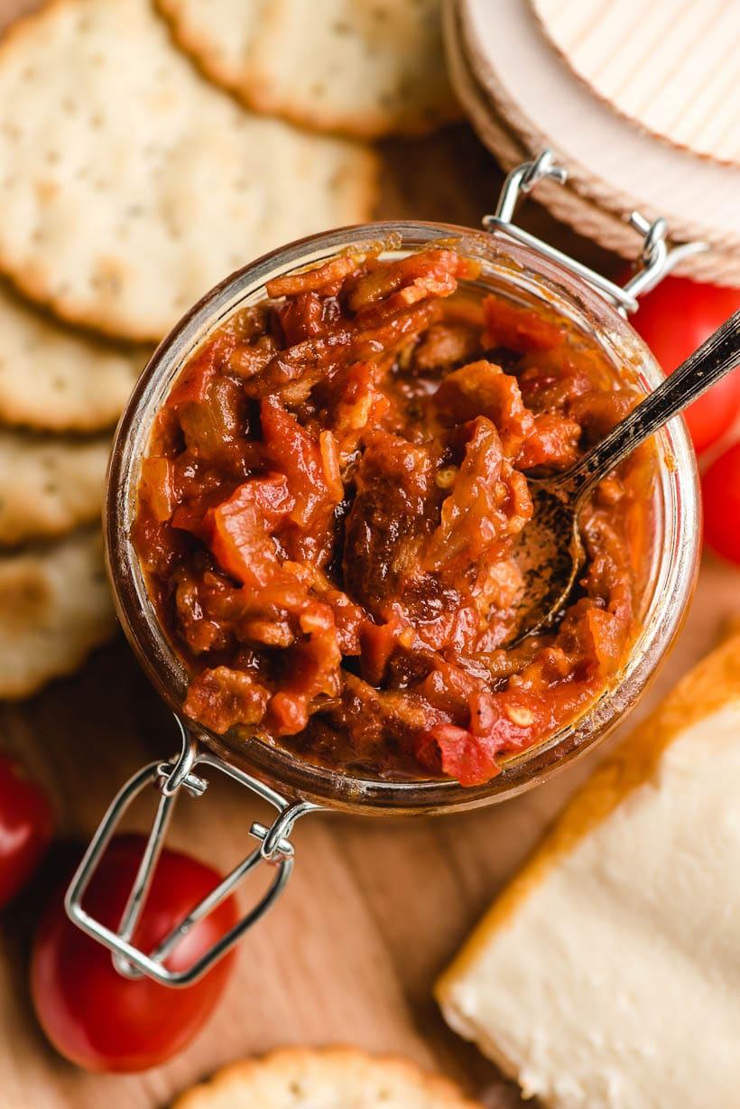 Small spoon in a jar of tomato jam.