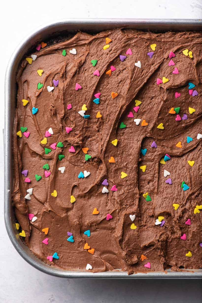 crazy cake with chocolate frosting and sprinkles