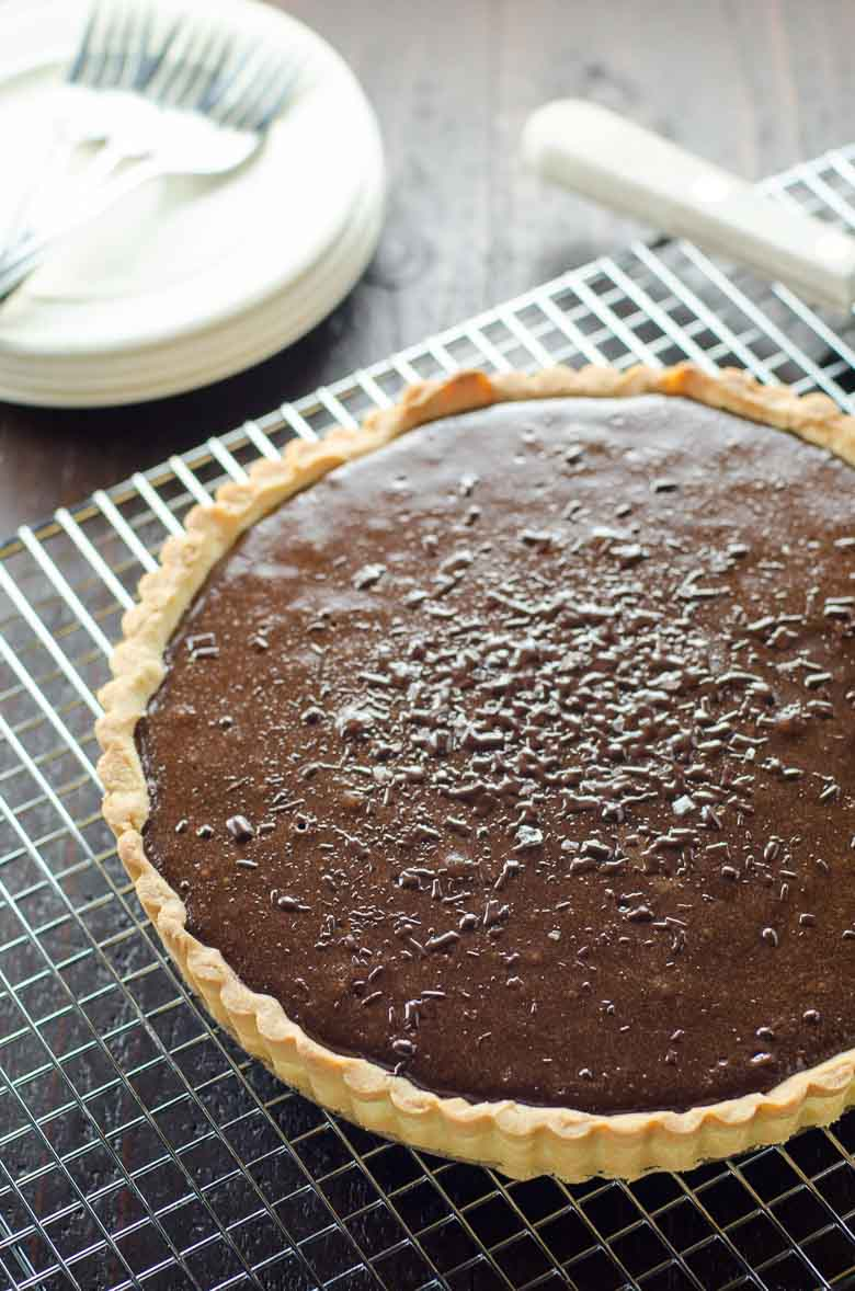 Chocolate Tart on a cooling rack