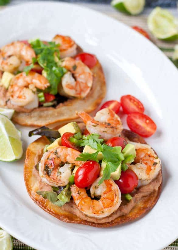 Margarita Shrimp Tostadas feature juicy shrimp highlighted with the taste of lime, tequila, and cilantro.