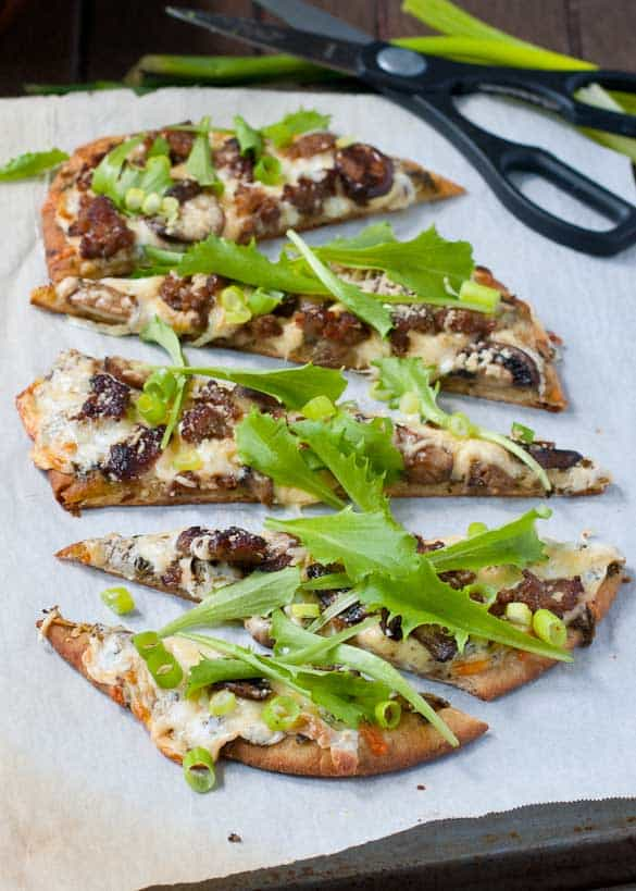 Three Cheese Naan Pizza with Sausage and Arugula