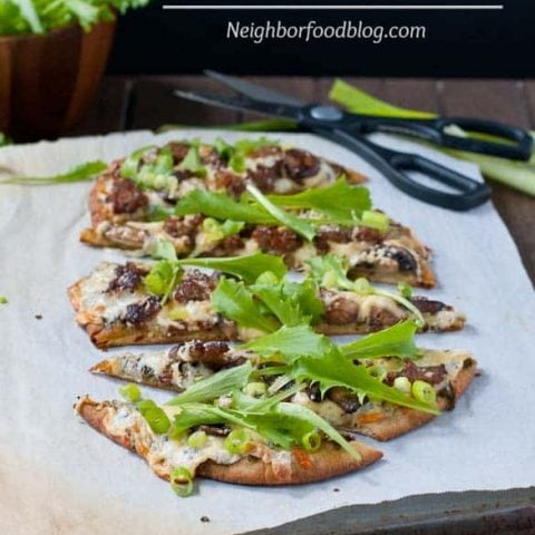 3 Cheese Naan Pizza with Sausage, Mushrooms, and Arugula