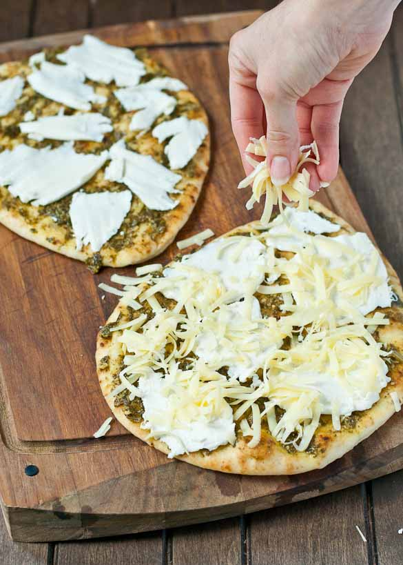 Three cheeses, sausage, and fresh arugula make this naan pizza super flavorful!