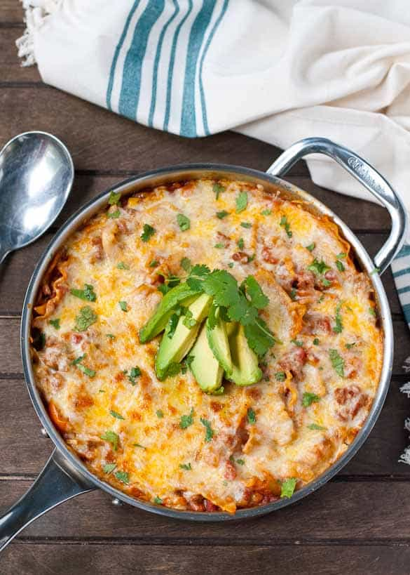 This Enchilada Skillet Lasagna is loaded with veggies and tex-mex flavors!