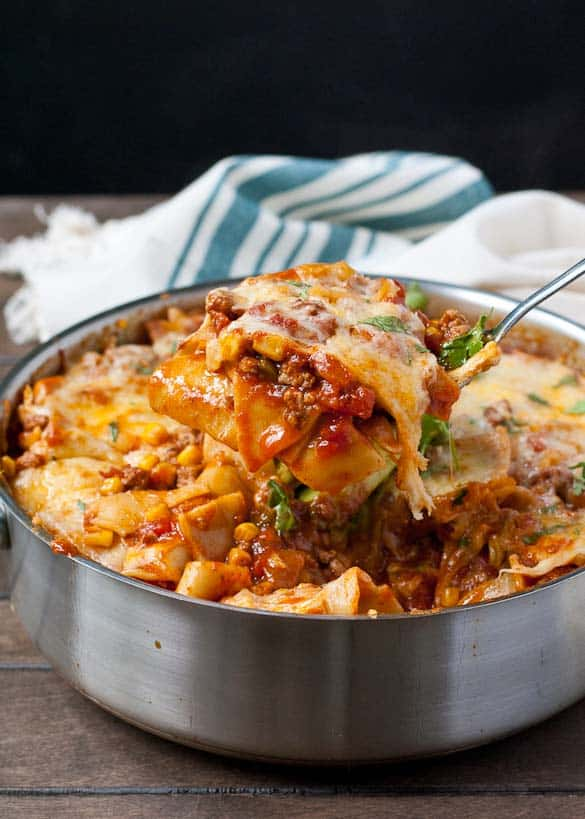 Cheesy Tex-Mex Enchilada Skillet Lasagna--a comforting weeknight meal that's loaded with veggies!
