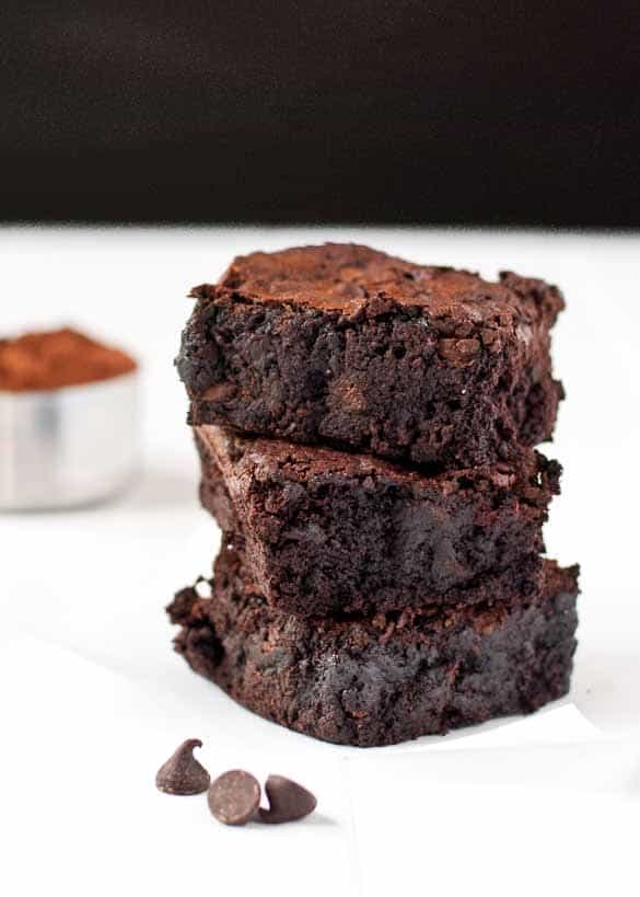 Ultimate Easy Fudge Brownie Recipe studded with chocolate chips.