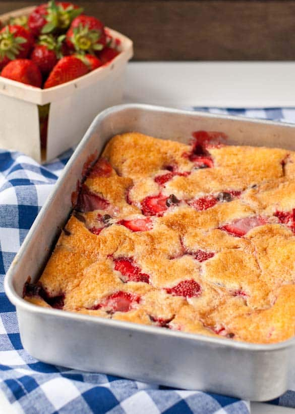 Warm Strawberry Cobbler studded with chocolate chips. All that's needed is a scoop of ice cream!