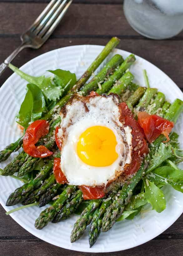 This Warm Asparagus and Tomato Salad is perfect for a light, gluten free, summer lunch.