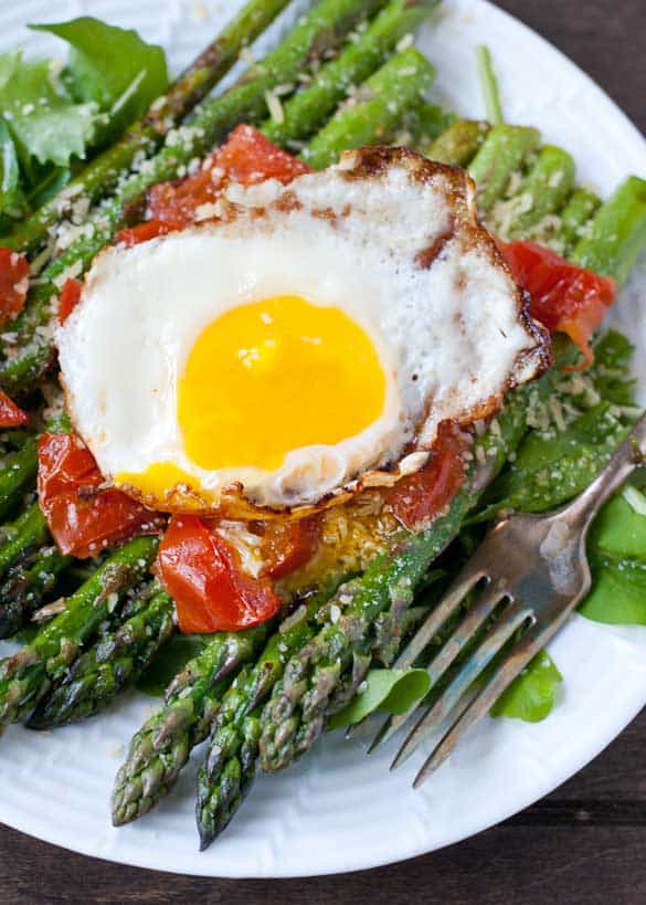 This Warm Asparagus and Tomato Salad makes for a satisfying vegetarian meal.