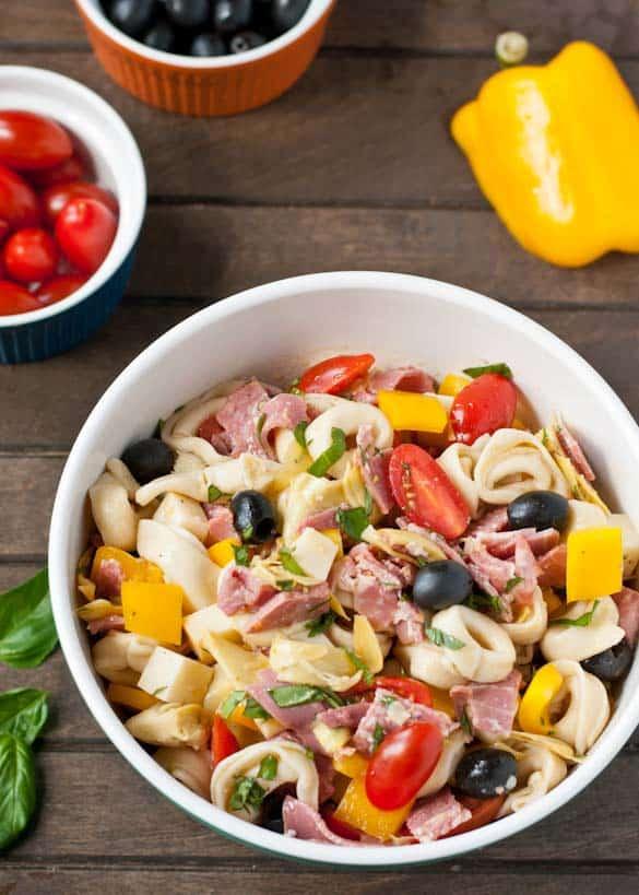Antipasto Tortellini Salad packed with smoked provolone, ham, salami, artichokes, and fresh veggies!