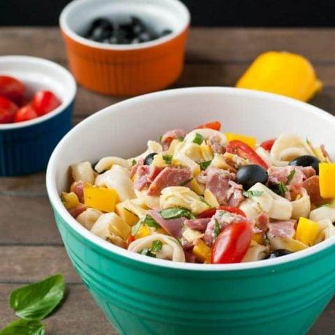 Salami, ham, cheese, and veggies make up this robust Antipasto Tortellini Salad.