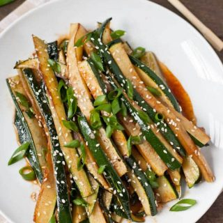 Spicy Asian Zucchini on a white plate