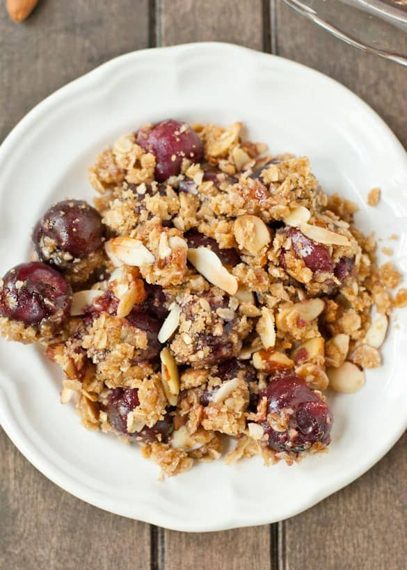 Juicy cherries covered in a crunchy almond butter crumble. All it needs is a scoop of ice cream!