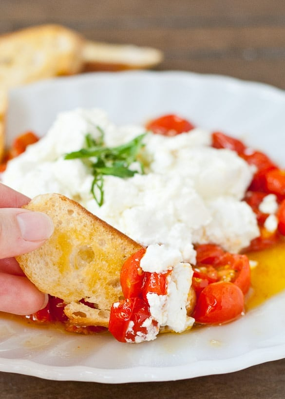 Fabulously sweet roasted cherry tomatoes are perfect with a mound of warm goat cheese. An easy and impressive appetizer.
