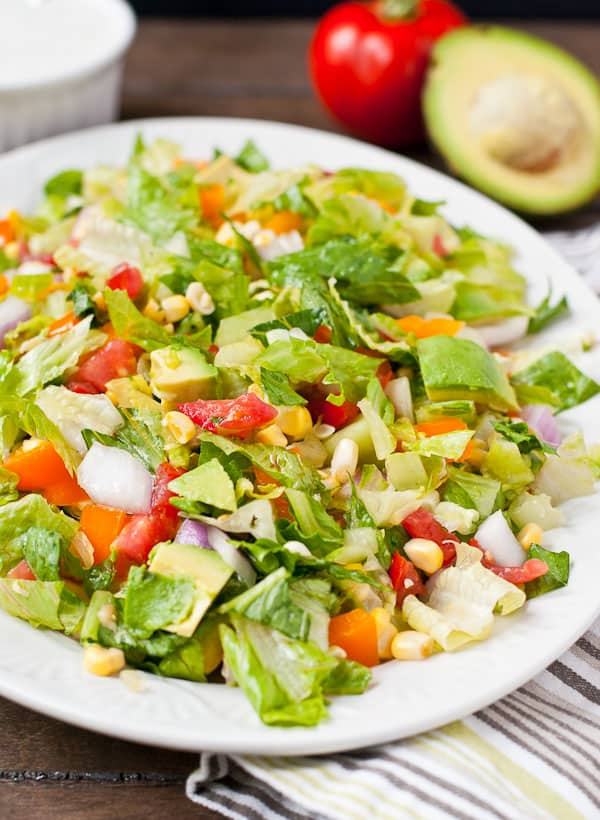 Juicy summer tomatoes and corn are the stars of this summer chopped salad!