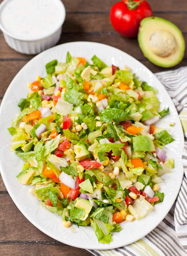The best of summer is all wrapped up in this Tomato, Corn, and Avocado Chopped Salad.