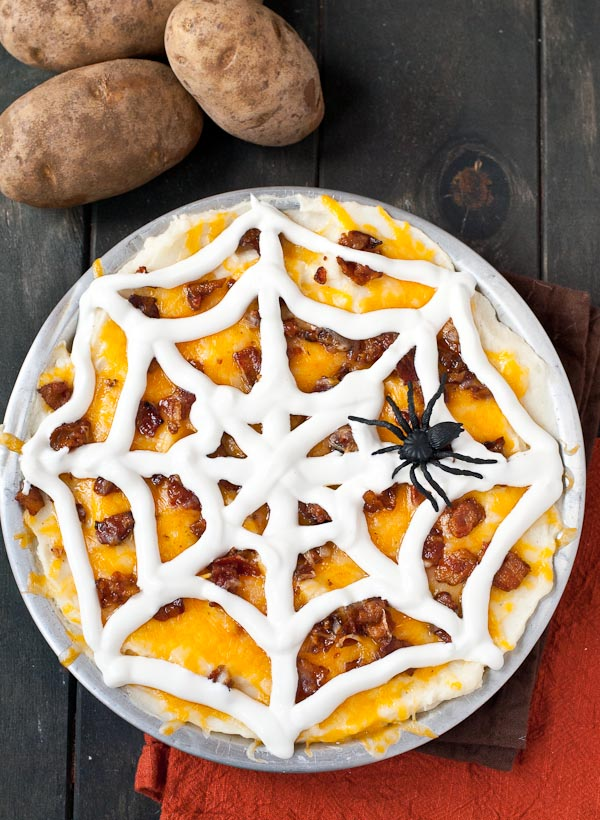 This Creamy Loaded Mashed Potato Casserole is ready to add some spook to your Halloween party!