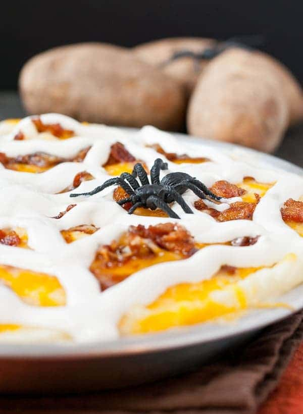 Mashed potatoes get creepy in this casserole loaded with cheese, bacon, and a sour cream spider web!