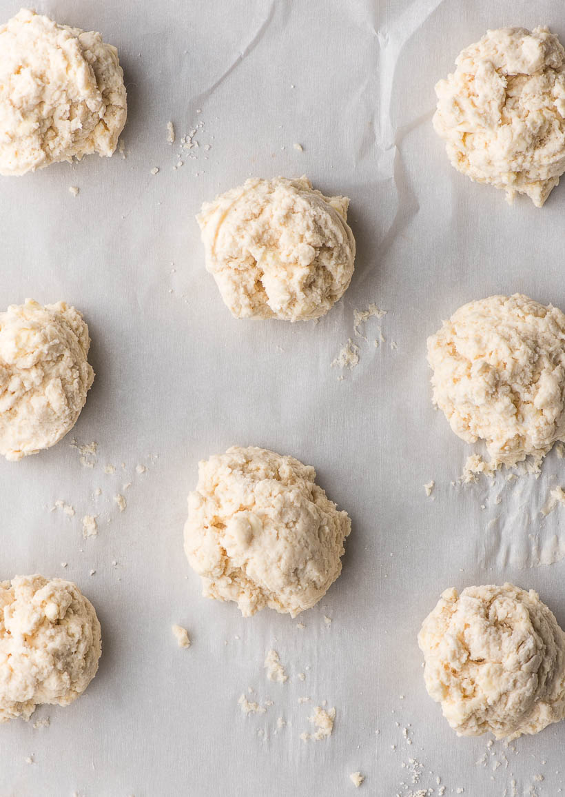 unbaked drop biscuits on a sheet pan