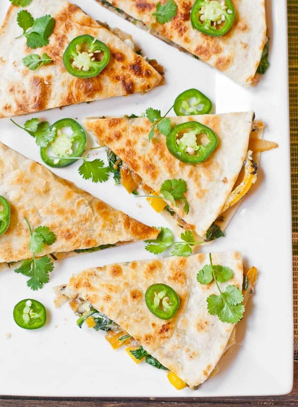 vegetarian quesadilla slices topped with jalapeno peppers and cilantro
