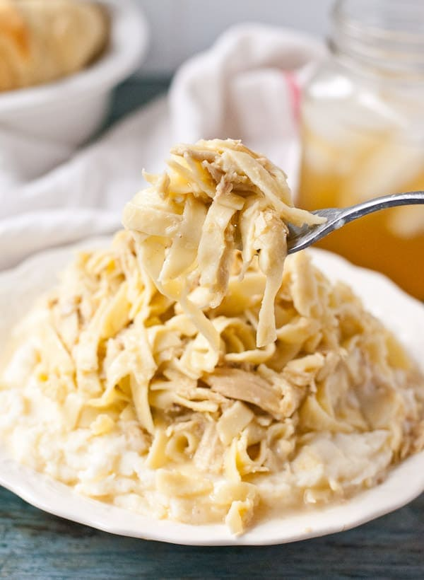 These Chicken and Noodles are a classic Amish dish, perfect served over fluffy mashed potatoes!