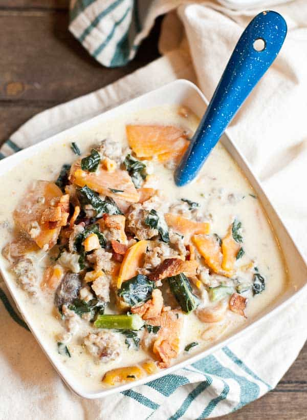 Savory and satisfying, this Creamy Kale, Sweet Potato, and Sausage Soup hits the spot on a cold winter night!