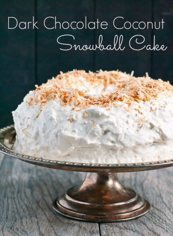 This Chocolate Snowball Cake is covered in a fluffy coconut frosting for the perfect winter dessert!