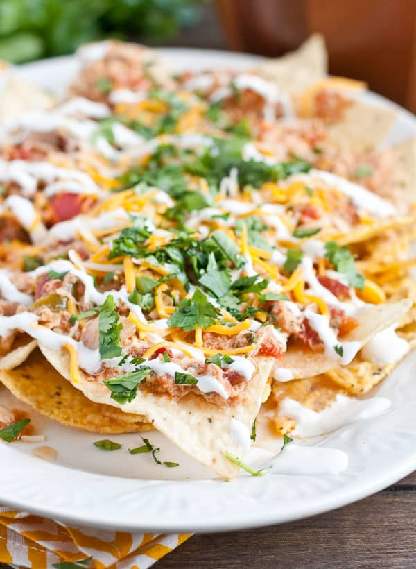 Chicken Chilaquiles are a spicy, cheesy, fresh take on nachos you can make in your slow cooker!