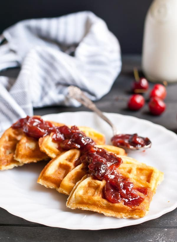 Crispy Vanilla Bean Waffles with Cherry Compote are a summer breakfast treat!