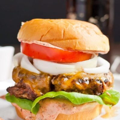 Smoky Cajun Burgers are slathered in a killer sweet and spicy Cajun sauce.