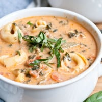 Looking for a great one pot meal recipe? This Creamy Tomato Tortellini Soup is easy to make and loaded with veggies and chicken sausage. It also freezes beautifully!