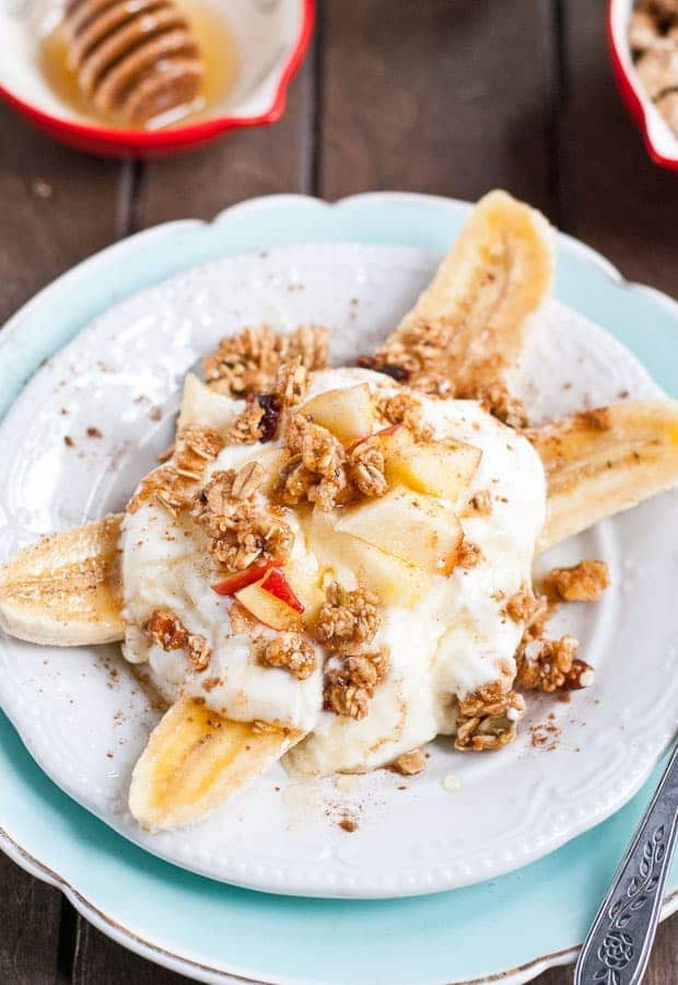 These Breakfast Banana Splits are loaded with apples, granola, yogurt, honey, and cinnamon!