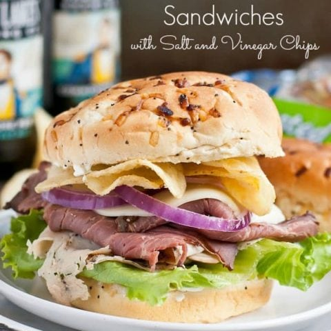 These Roast Beef and Turkey Sandwiches are piled high with salt and vinegar chips and a cream cheese spread. Perfect for tailgating!