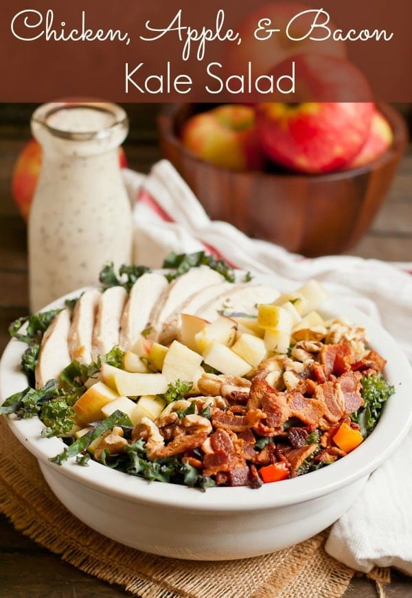 This hearty kale salad is loaded chicken, bacon, apples, and walnuts with a balsamic poppyseed dressing.