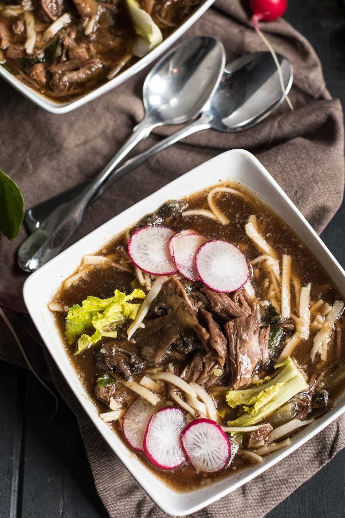 This Slow Cooker Asian Beef and Mushroom Soup recipe is loaded with garlic, ginger, and Sriracha for a warm and comforting weeknight meal.